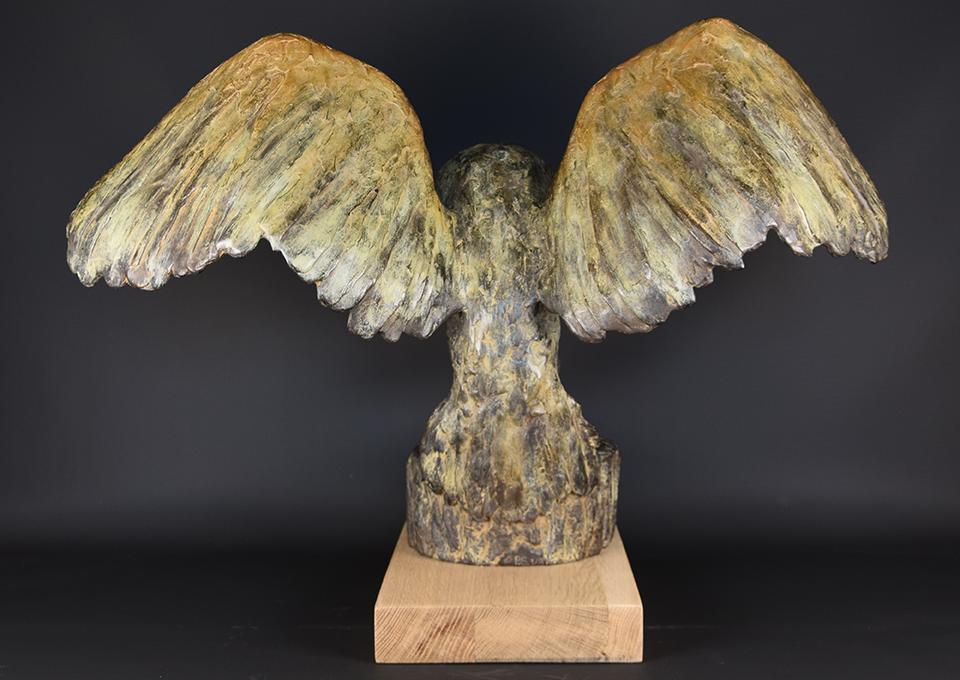 Uil-in-brons-achterkant